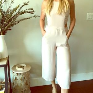 Cream colored jumpsuit with side cutout